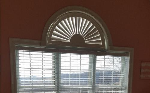 Blind Wizard - Plantation Shutters, Blinds, and Shades in West Virginia - Sunburst Arched Shutter over White Faux Wood Blinds